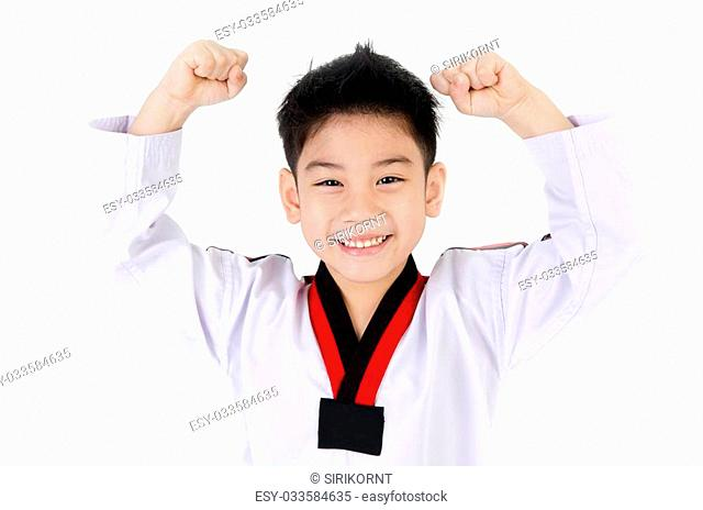 little smile boy in a Taekwondo suit with a white sash on a white background
