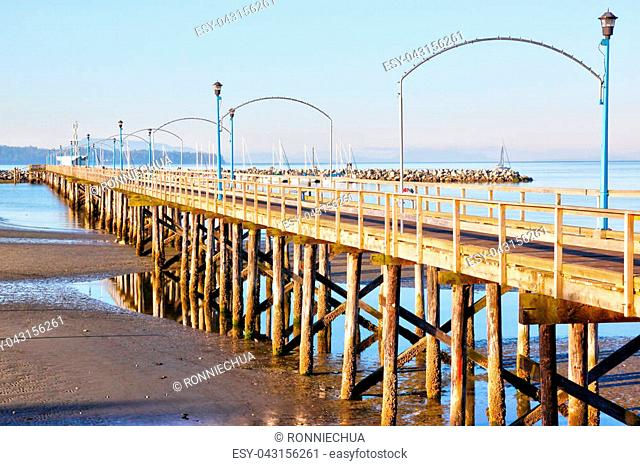 Low tide at the famous 1,500 ft. long wooden pier in White Rock, BC, surrounding Semiahmoo Bay near Vancouver. The area is popular for its 2