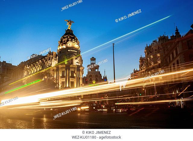 Spain, Madrid, Gran Via Street and Metropolis building at night