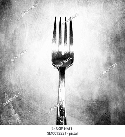 A fork on a textured background