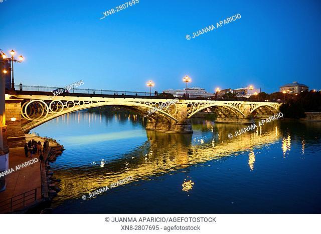 Isabel II bridge or Triana bridge, in Guadalquivir river at Evening,Sevilla,Andalucía,Spain, Europe