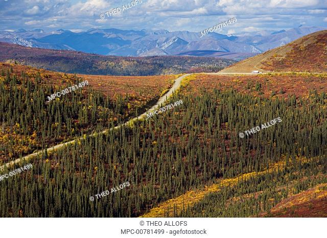 Recreational vehicle driving on the Top of the World Highway between Dawson City, Yukon, and Tok, Alaska