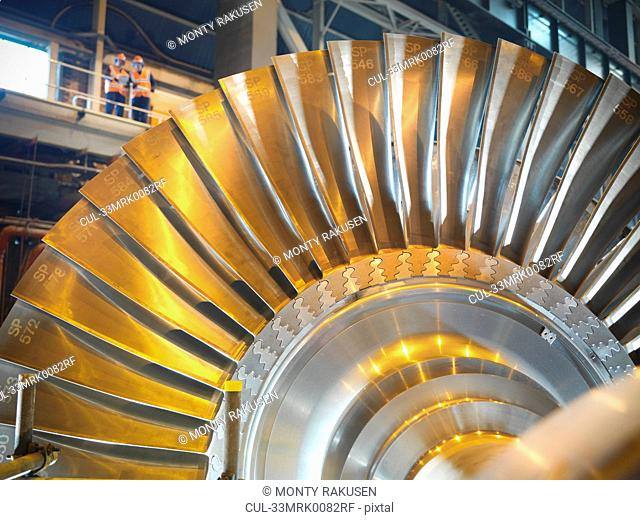 Workers with turbine in power station