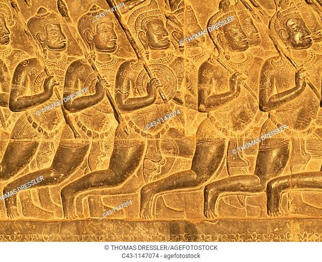 Cambodia - Bas-reliefs of warriors at the west side of the third gallery in the temple of Angkor Wat  The temple complexes of Angkor 'city' were the heart of...