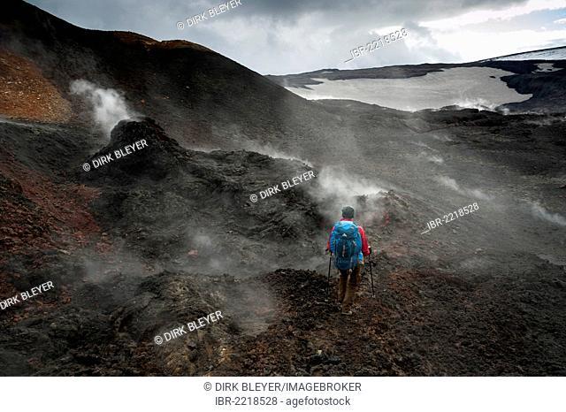 Hiker in the steaming Goðahraun, Godahraun lava field, solfatars on the Fimmvoerðuháls volcano, hiking trail to the Fimmvoerðuháls, Fimmvoerduhals plateau