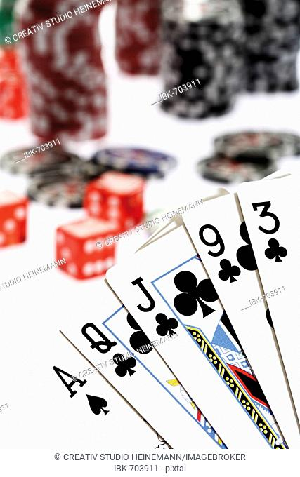 Flush hand with poker chips in background