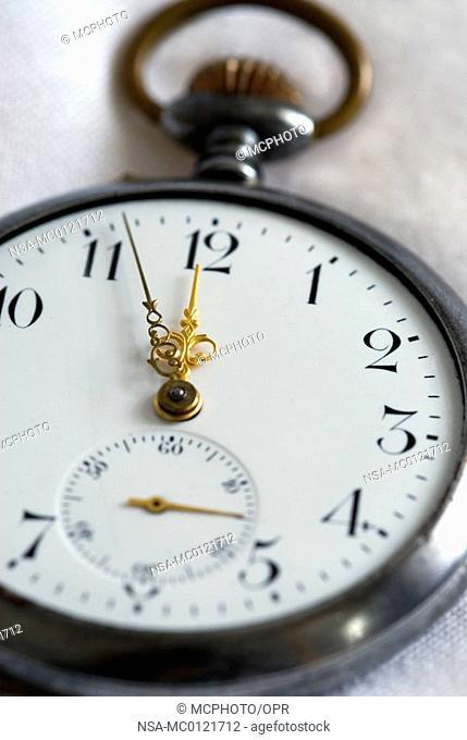 antique Pocket Watch Showing Five to Twelve