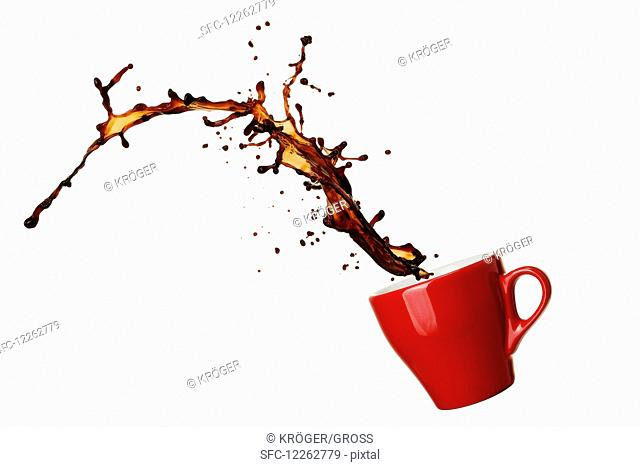 An espresso cup with a splash of coffee