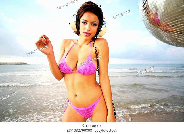 beautiful sexy latin bomb-shell dancing and posing at a beach in the early morning. useful for style fashion and music events