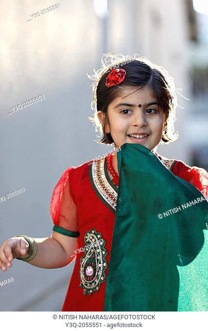 Portrait of an indian american girl playing outdoors