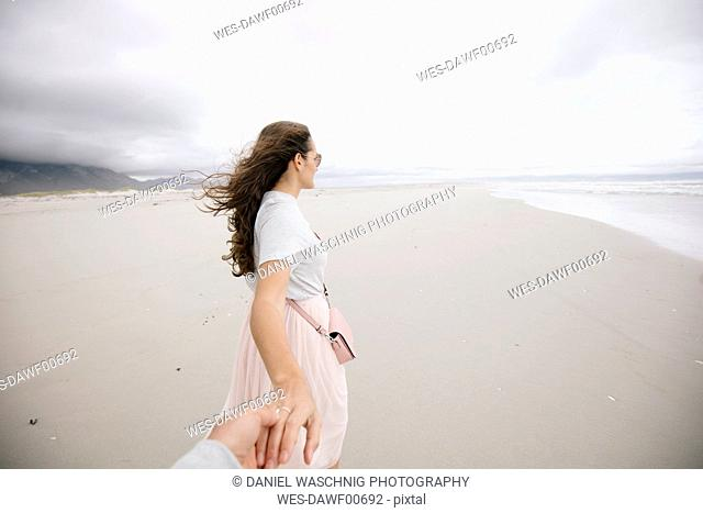 South Africa, Western Cape, Hermanus, woman holding hand on the beach