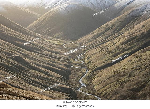 View down Langdale Valley to snow capped Cobles in winter in the Howgill Fells near Sedbergh, Cumbria, England, United Kingdom, Europe