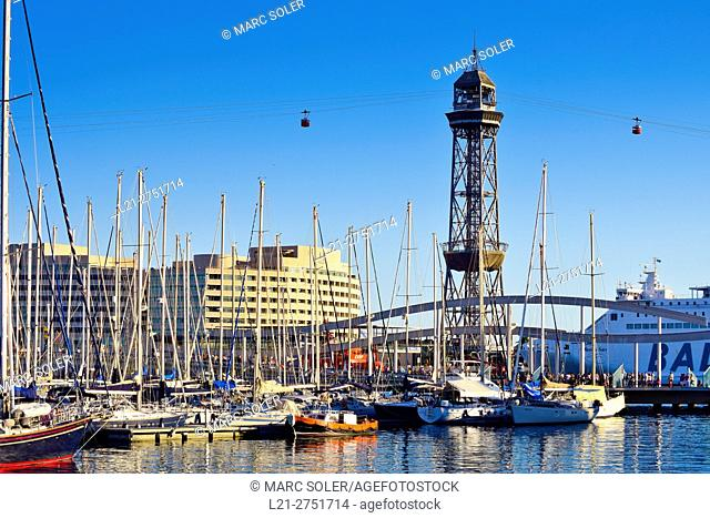 Old Harbor, Old Port, Port Vell. Rambla de Mar Bridge, World Trade Center building and Teleferic Tower in background. Barcelona, Catalonia, Spain