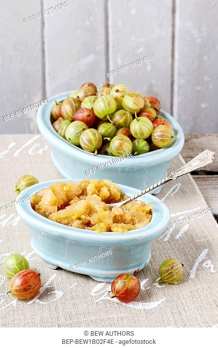 Bowls of gooseberries and jam. Healthy fruits