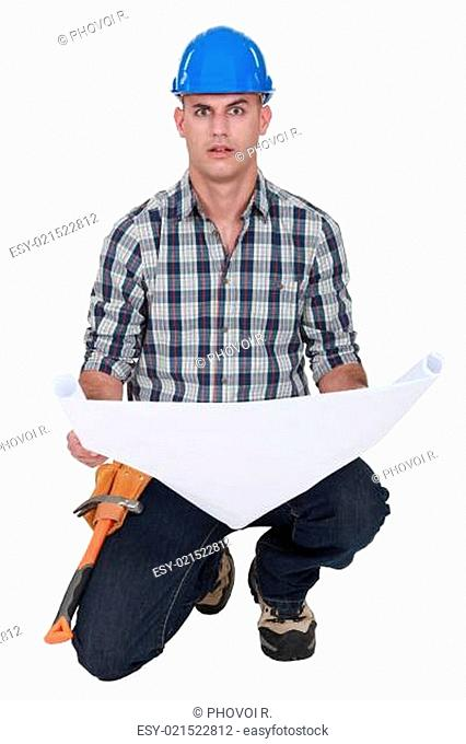 portrait of foreman holding blueprints