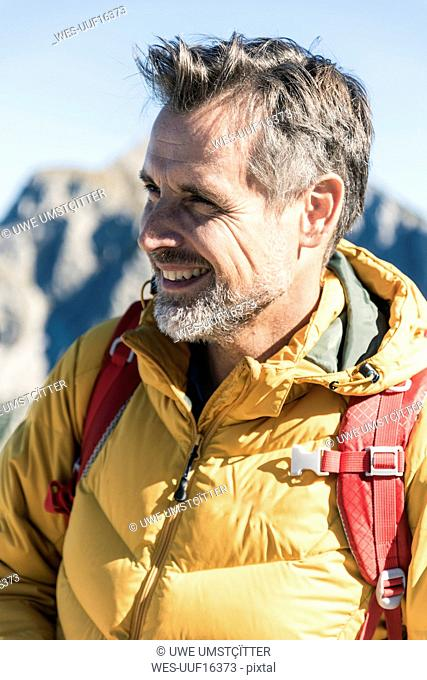 Austria, Tyrol, portrait of smiling man on a hiking trip in the mountains