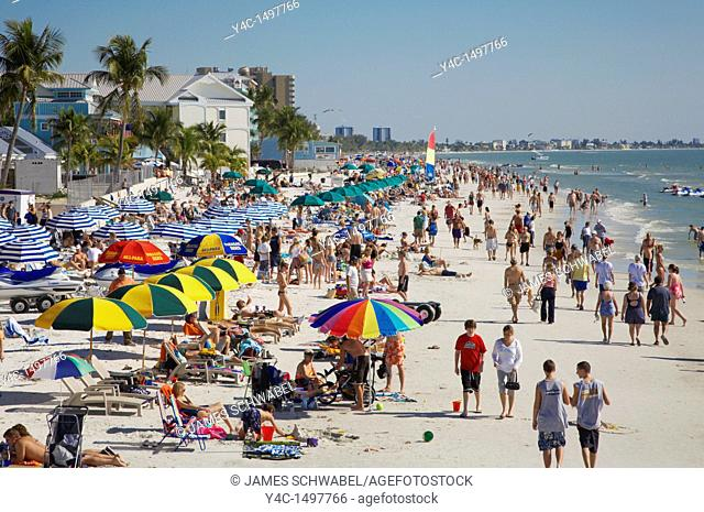 Sunbathers on Fort Myers Beach on the Gulf of Mexico in Southwestern Florida