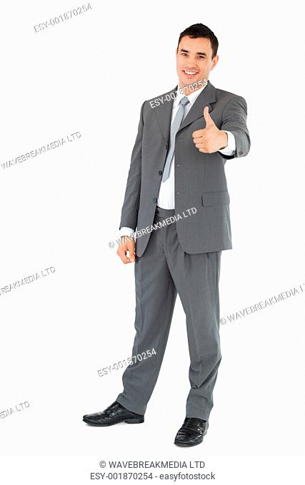 Businessman thumb up against a white background