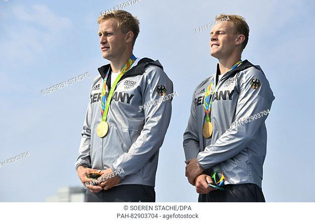 Max Rendschmidt (L) and Marcus Gross of Germany display their Gold medals after winning the Men's Kayak Double 1000m final of the Canoe Sprint events of the Rio...