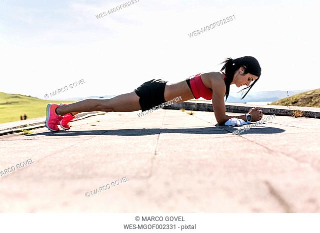 Woman doing push ups, outdoor