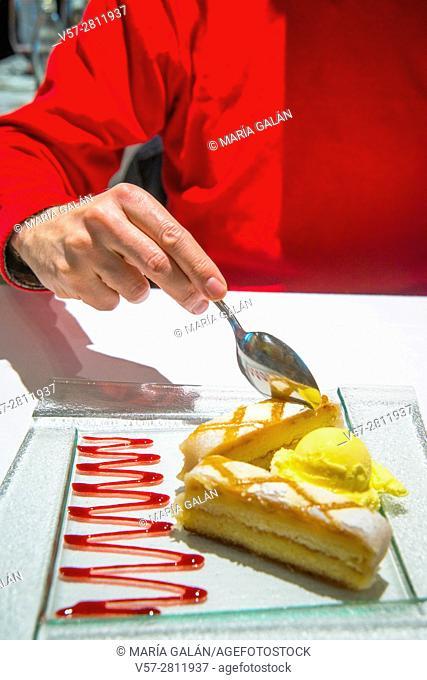 Man's hand having ponche segoviano in a restaurant. Segovia, Spain