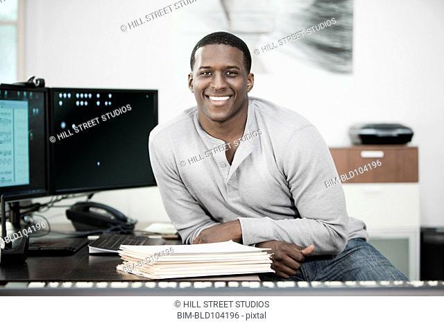Black man sitting with paperwork
