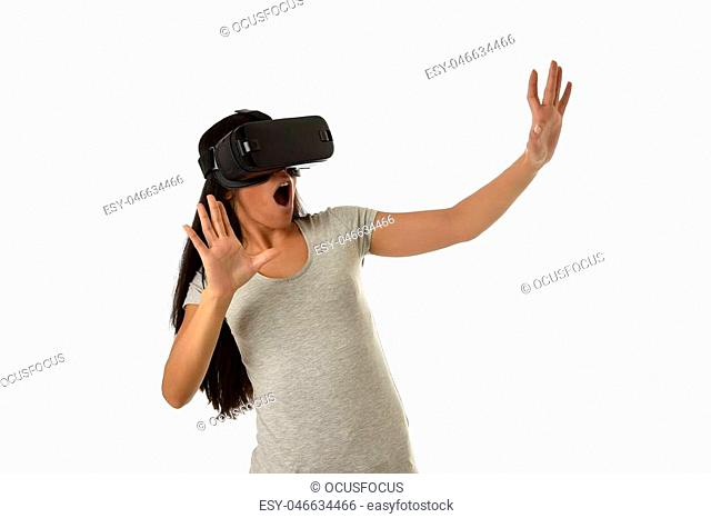 young attractive happy woman excited using 3d goggles watching 360 virtual reality vision enjoying cyber fun experience in vr simulation reality and new gaming...