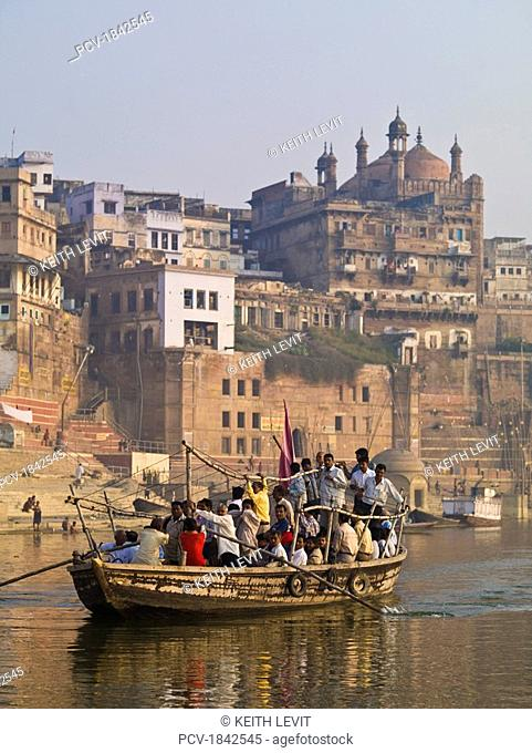 The Ganges,Varanasi,India,Boat full of people on the river