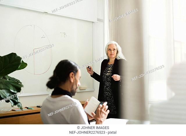Woman during presentation in board room