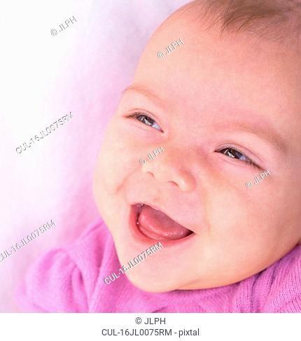 Portrait of baby girl, smiling