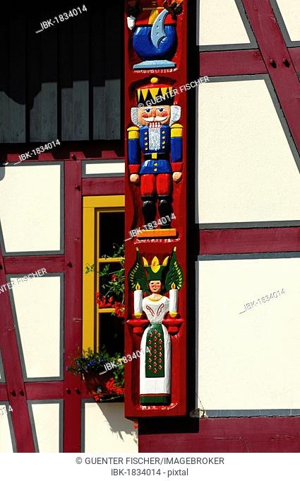 Carvings from the Erzgebirge Christmas themes, nutcracker soldier, candle-bearing miner and angel, on the corner of a half-timbered house, Seiffen, Erzgebirge
