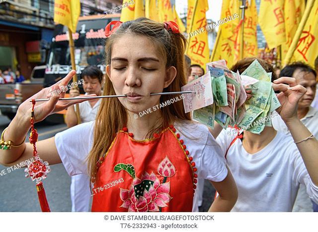 Self mutilation: Vegetarian festival devotee in Bangkok, Thailand