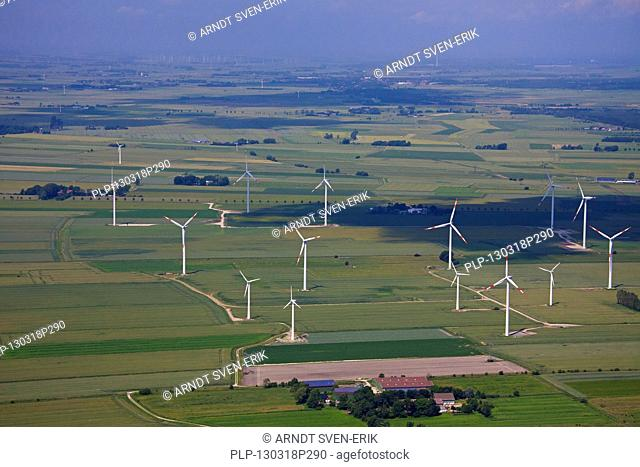 Aerial view over windturbines at wind farm