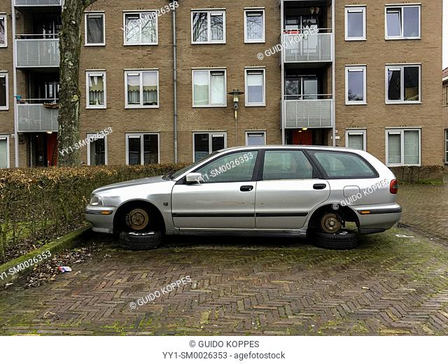 Tilburg, Netherlands. Elder Volvo in Need of Repairs and with his wheels disattached stashed for long term period on a residential parking lot