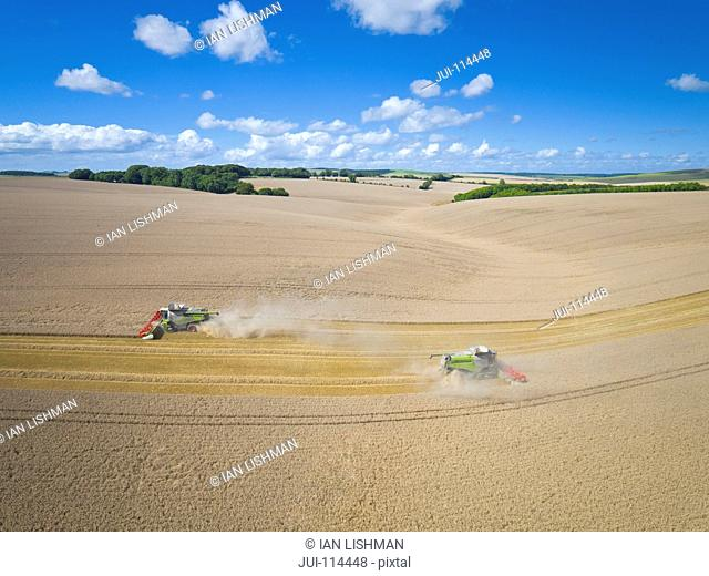 Aerial View Of Two Combine Harvesters Harvesting Wheat Crop