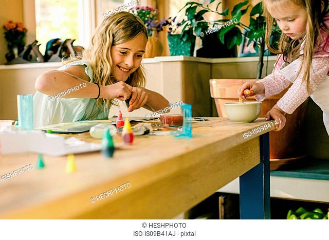 Two girls doing science experiment at table