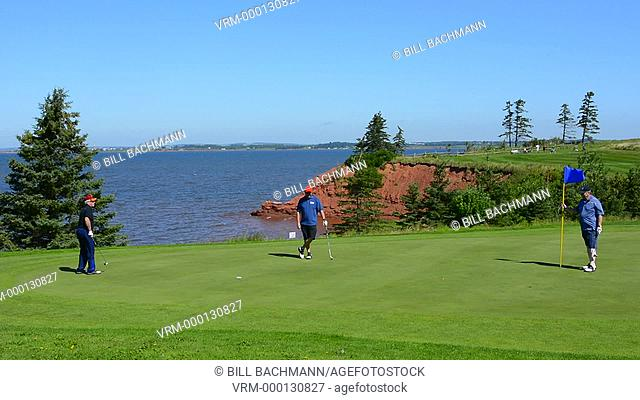Canada Prince Edward Island, P.E.I. golfing at Belfast Highland Greens near ocean with cliff and golfers