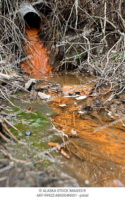 Rust colored water running through a drainage culvert, Alaska