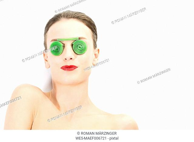 Young woman wearing glasses of fruit gum, close up