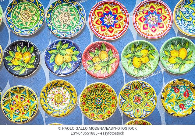 Souvenir from Sicily: fridge magnets with colourful design. Useful for background