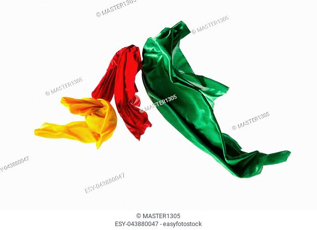 Smooth elegant transparent yellow, red, green cloth isolated or separated on white studio background. Texture of flying fabric