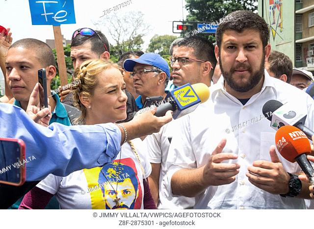 """Lilian Tintori, wife of political leader Leopoldo Lopez, and Mayor David Smolansky giving statements to the press. The opposition mobilization called """"""""Great..."""