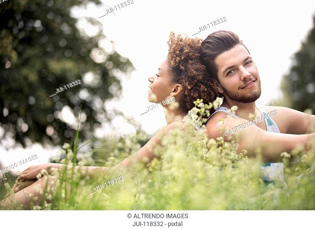 Romantic Young Couple Relaxing In Countryside Together