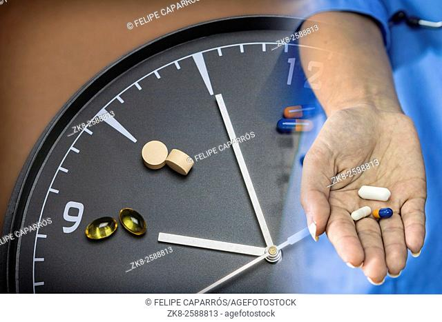 concept for Healthcare And Medicine, a clock marks the time of taking medicines