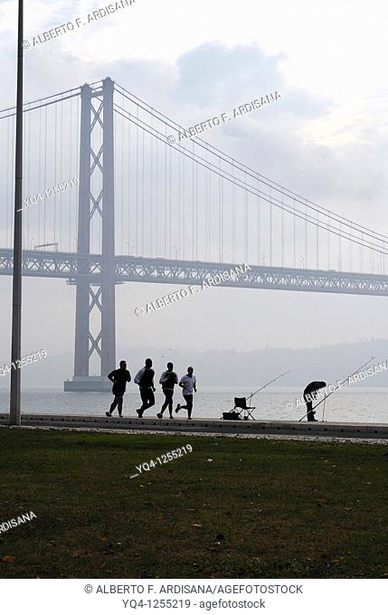 Running along the river Tejo, Lisbon, Portugal