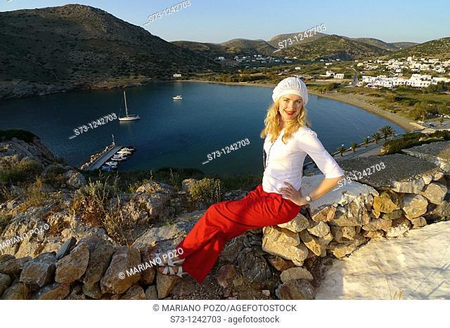 Woman sitting in Galissa beach, Galissa, Syros island, Greek Island, Cyclades, Greece, Europe
