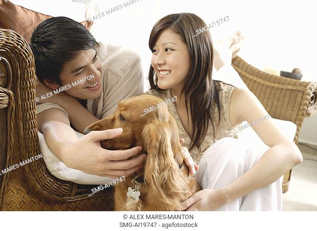 Couple at home with Cocker Spaniel dog