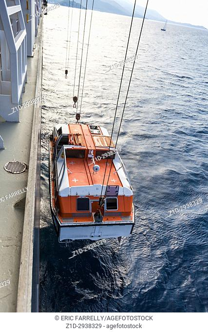 Raising lifeboat from sea back to ship Korcula Queen Victoria