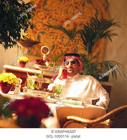 Arab businessman having lunch break