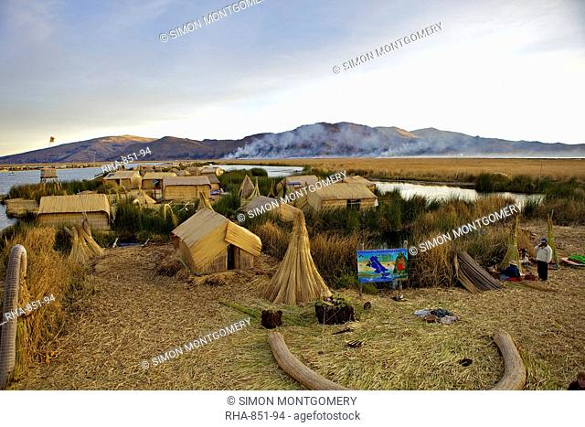 Floating islands of the Uros people, traditional reed boats and reed houses, Lake Titicaca, peru, peruvian, south america, south american, latin america